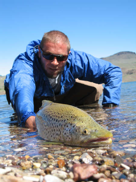 Picture of Rodrigo Amadeo fly fishing in Patagonia with a nice brown trout