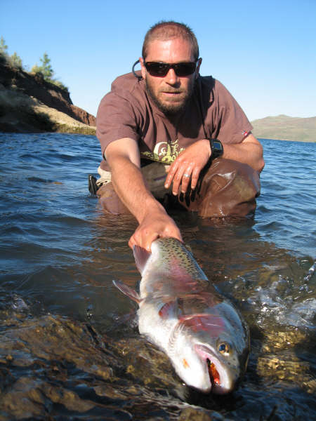 Rodrigo Amadeo with a nice rainbow trout caught fly fishing in Patagonia